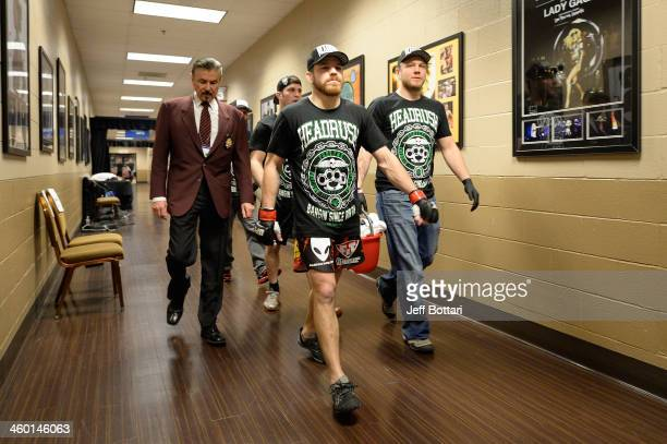 Jim Miller walks out of the locker room before facing Fabricio Camoes in their lightweight bout during the UFC 168 event at the MGM Grand Garden...