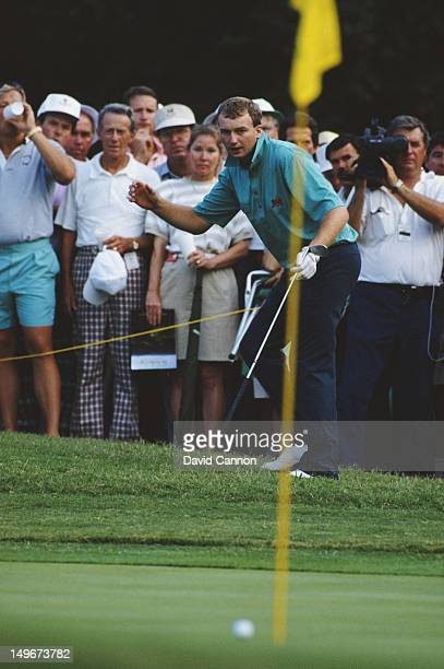 Jim Milligan of the Great Britain and Ireland team holes his chip on the 17th hole in his singles match against Jay Sigel during the Walker Cup...