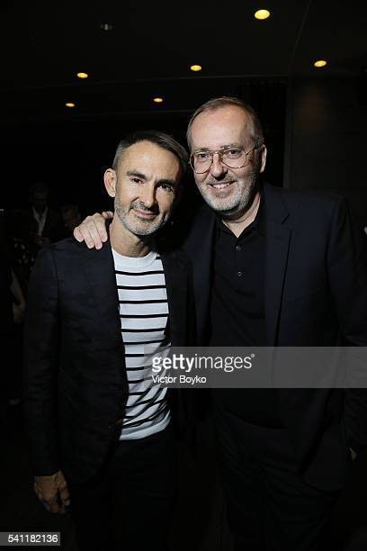 Jim Moore and Neil Barrett attend GQ celebration of Milan Men's Fashion Week 2016 at Radio Rooftop Bar at ME Milan Duca on June 18 2016 in Milan Italy