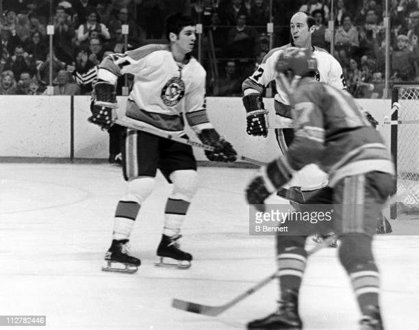 Jim Morrison and Michel Briere of the Pittsburgh Penguins skate on the ice during an NHL game against the St Louis Blues circa 1969 at the St Louis...