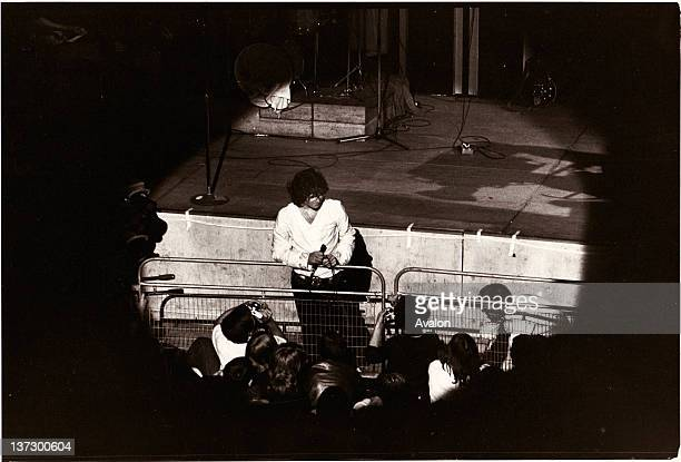 Jim Morrison of The Doors in concert performing live at the Round House Chalk Farm London in the late 1960's The Doors were an American rock band...