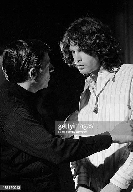 Jim Morrison of The Doors, right, on THE SMOTHERS BROTHERS COMEDY HOUR. Image dated January 6, 1969.