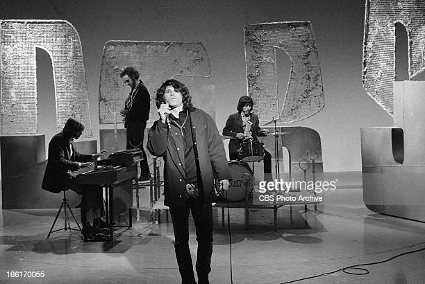 Jim Morrison of The Doors right on THE SMOTHERS BROTHERS COMEDY HOUR Image dated January 6 1969
