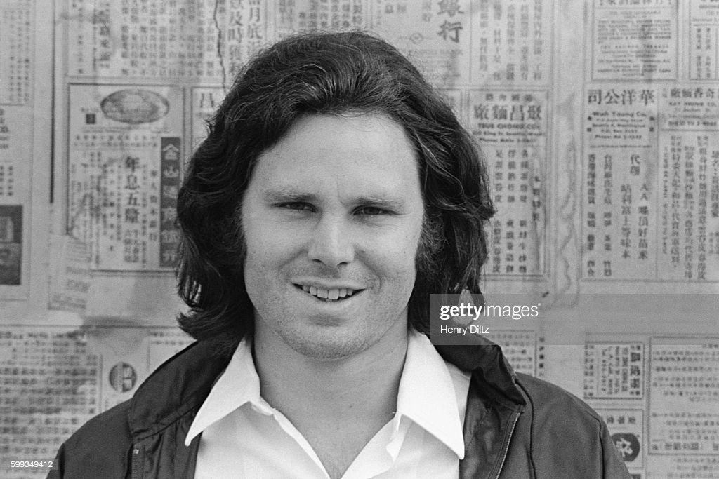 Jim Morrison of The Doors stands in front of a wall covered in Chinese newspapers.  sc 1 st  Getty Images & Jim Morrison Photos u2013 Pictures of Jim Morrison | Getty Images pezcame.com