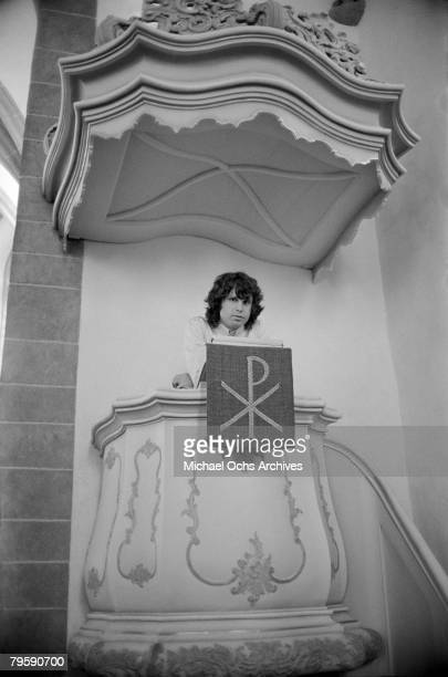 Jim Morrison of the Doors visits a church while on tour on September 14 1968 in Frankfurt West Germany