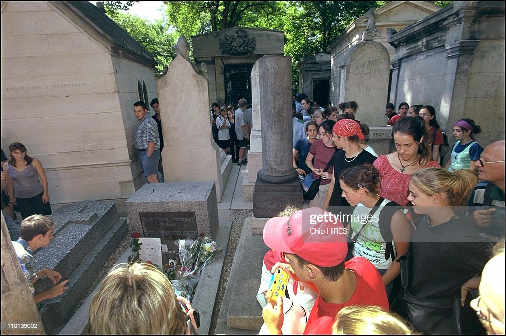 Jim Morrison's grave in the Pere Lachaise cemetary in Paris, France. 3rd of July, 2001 is the 30th anniversary of his death in Paris, France. : News Photo