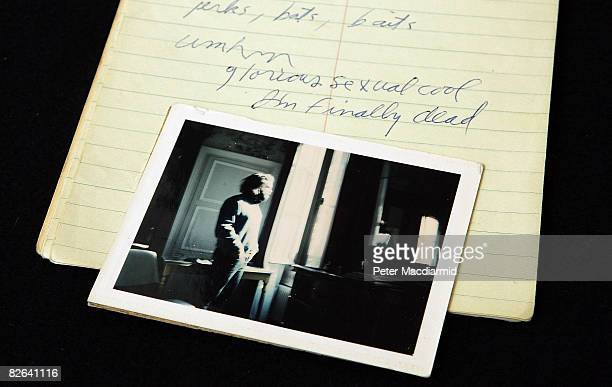 Jim Morrison's last notebook containing poems a photograph of the singer is displayed at the Idea Generation Gallery on September 3 2008 in London...