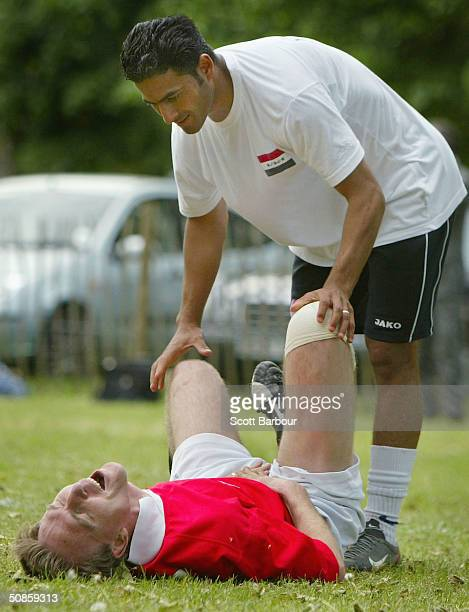 Jim Murphy British member of parliament playing for the Parliamentary Football team lies on the ground in pain after he was hit by the ball as Mahdi...