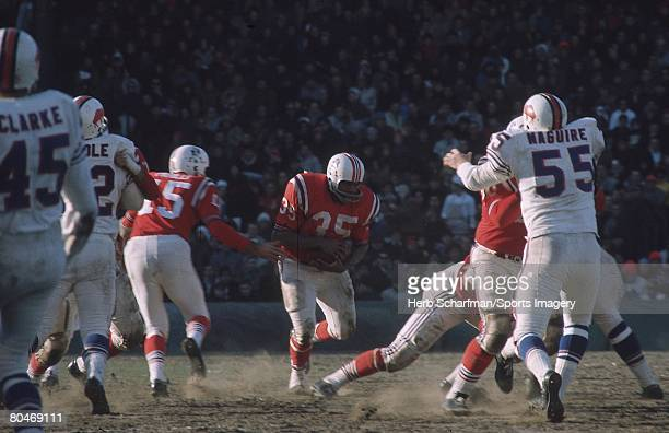 Jim Nance of the Boston Patriots carries the ball during an American Football League game against the Buffalo Bills on December 4 1966 in Boston...