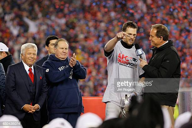Jim Nantz interviews Tom Brady of the New England Patriots as team owner Robert Kraft and head coach Bill Belichick look on after the Patriots...