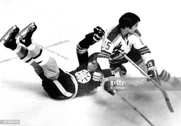 Jim Neilson of the New York Rangers checks Bobby Orr of the Boston Bruins during Game 2 of the 1970 Quarter Finals on April 9, 1970 at the Boston...