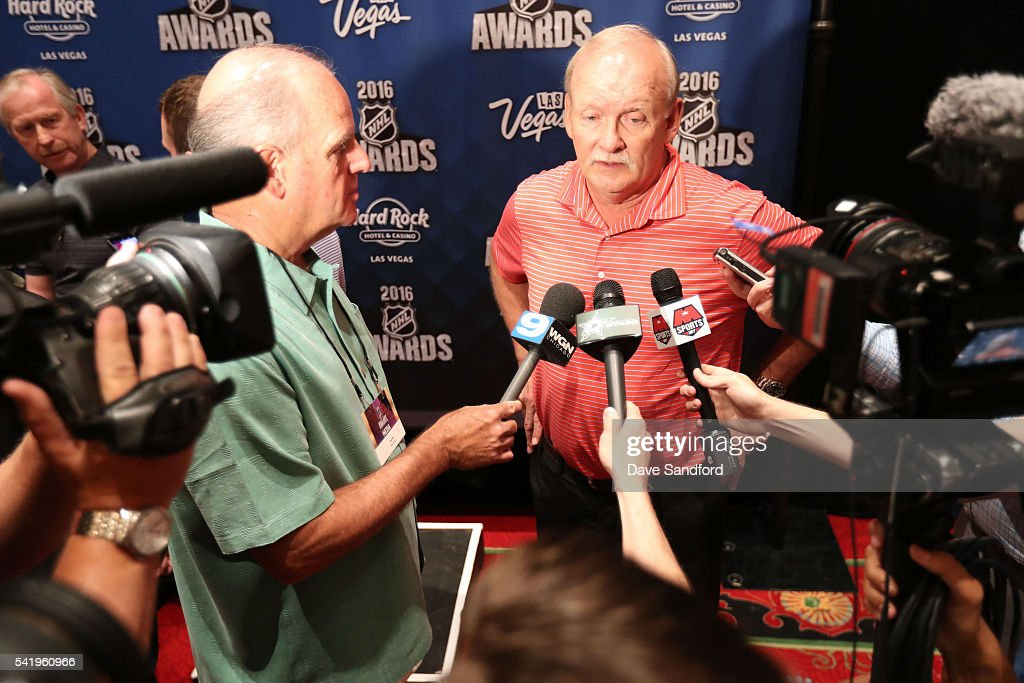 GM Jim Nill of the Dallas Stars, far left, and head coach Lindy Ruff of the Dallas Stars, right, speak with the media during a press availability at the Encore Ballroom on June 21, 2016 in Las Vegas, Nevada.