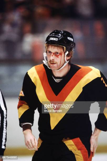 Jim Nill of the Vancouver Canucks skates to the penalty box bloodied after an altercation during an NHL game against the New York Rangers on October...