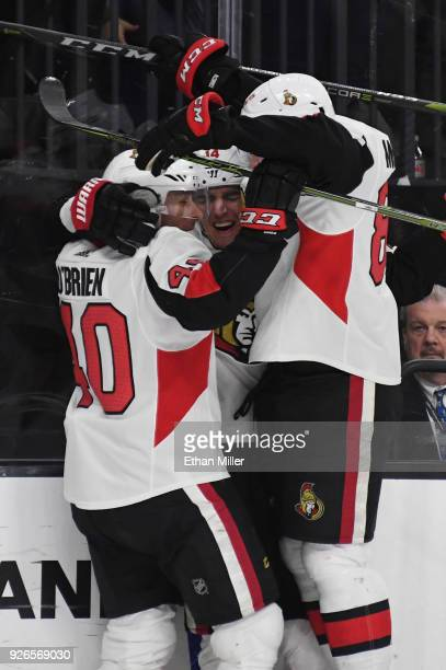 Jim O'Brien Alexandre Burrows and Max McCormick of the Ottawa Senators celebrate after Burrows scored a thirdperiod goal against the Vegas Golden...