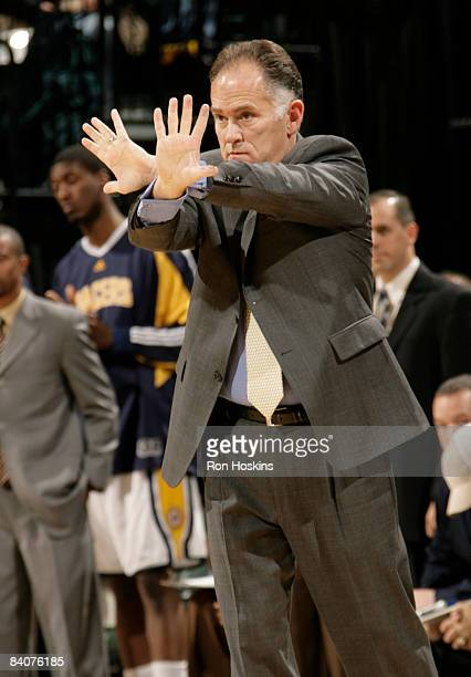 Jim O'Brien head coach of the Indiana Pacers directs his team to a victory over the Golden State Warriors 127120 at Conseco Fieldhouse on December 18...