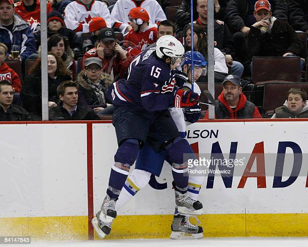 Jim O'Brien of Team USA body checks a member of a member of Team Kazakhstan during the IIHF World Junior Championships at Scotiabank Place on...