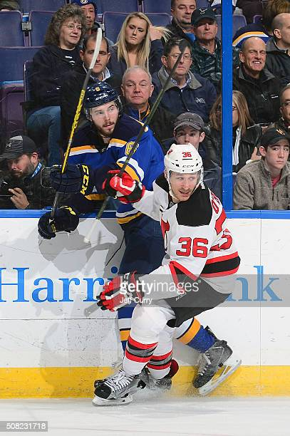 Jim O'Brien of the New Jersey Devils skates against Joel Edmundson of the St Louis Blues on January 12 2016 at Scottrade Center in St Louis Missouri