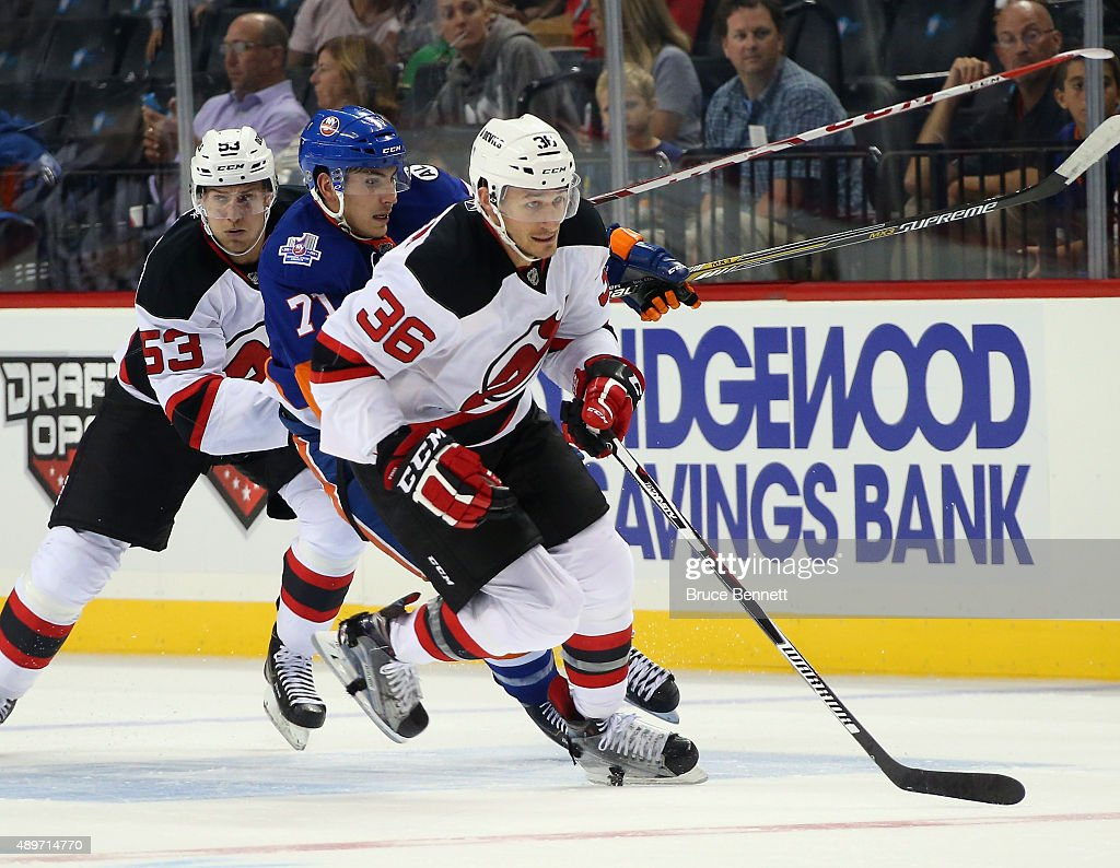 Jim O'Brien #36 of the New Jersey Devils skates against the New York Islanders at the Barclays Center on September 23, 2015 in the Brooklyn borough of New York City. The Islanders defeated the Devils 2-1.