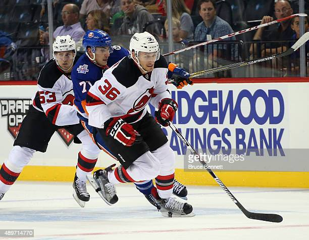 Jim O'Brien of the New Jersey Devils skates against the New York Islanders at the Barclays Center on September 23 2015 in the Brooklyn borough of New...