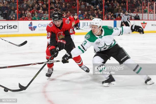 Jim O'Brien of the Ottawa Senators battles for puck possession against Mattias Janmark of the Dallas Stars at Canadian Tire Centre on March 16 2018...
