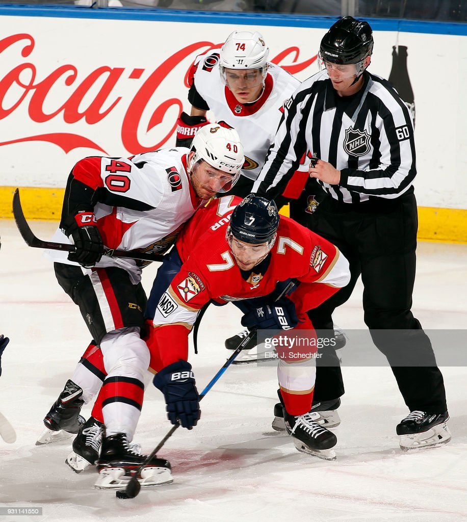 Jim O'Brien #40 of the Ottawa Senators faces off against Colton Sceviour #7 of the Florida Panthers at the BB&T Center on March 12, 2018 in Sunrise, Florida.