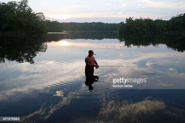Jim O'Meara of Medford fishes in Wright's Pond in Medford Massachusetts July 7 2014