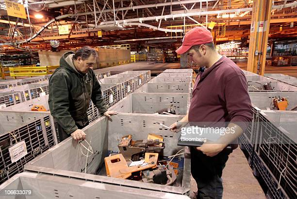 Jim Ozzello left and his son David look at items they might bid on during a liquidation auction at the permanently shutdown General Motors Co Pontiac...