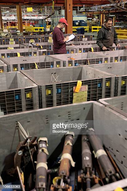 Jim Ozzello right and his son David look at items they might bid on during a liquidation auction at the permanently shutdown General Motors Co...