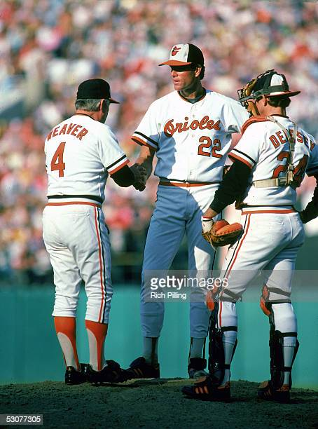 Jim Palmer of the Baltimore Orioles stands on the field with teammates during a game. Jim Palmer played for the Baltimore Oriole from 1965-1984.