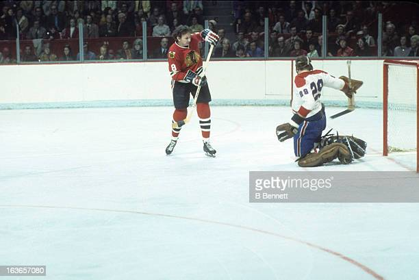 Jim Pappin of the Chicago Blackhawks shoots against goalie Ken Dryden of the Montreal Canadiens during the 1971 Stanley Cup Finals in May 1971 at the...