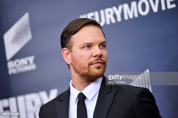 Jim Parrack poses for photographers on the red carpet during the The Fury Washington DC premiere at The Newseum on October 15 2014 in Washington DC