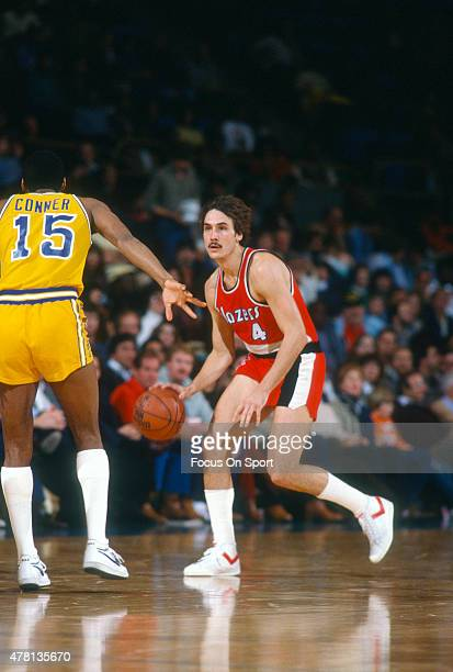 Jim Paxson of the Portland Trail Blazers dribbles the ball up court while defended by Lester Conner of the Golden State Warriors during an NBA...