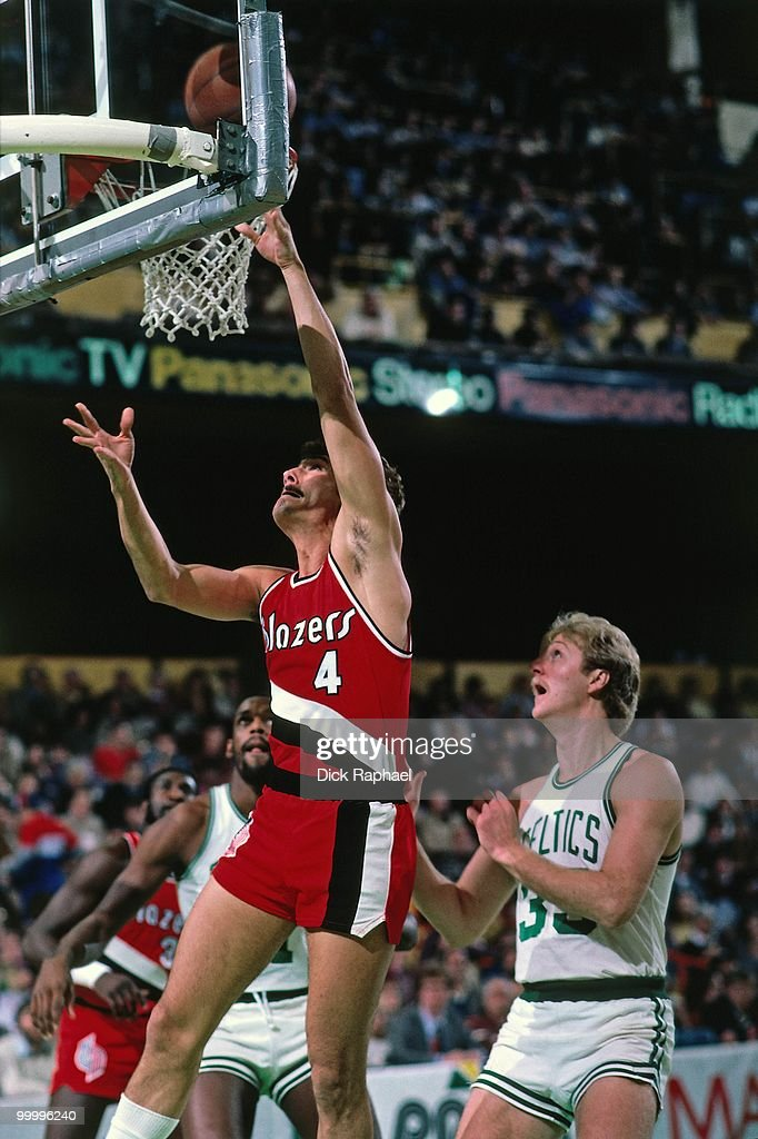 Jim Paxson #4 of the Portland Trail Blazers shoots a layup against Larry Bird #33 of the Boston Celtics during a game played in 1983 at the Boston Garden in Boston, Massachusetts.