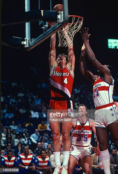 Jim Paxson of the Portland Trailblazers shoots over Elvin Hayes of the Washington Bullets during an NBA basketball game circa 1981 at The Capital...