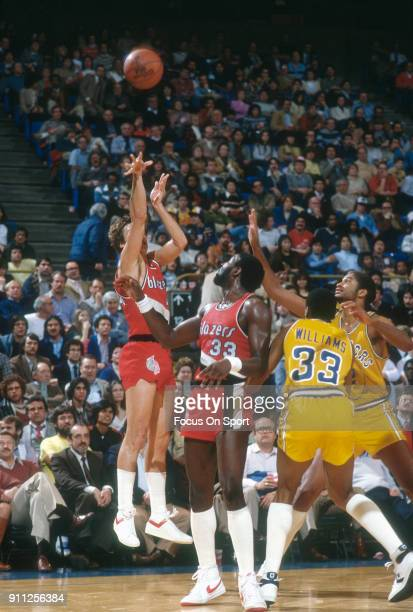 Jim Paxson of the Portland Trailblazers shoots over Joe Barry Carroll of the Golden State Warriors during an NBA basketball game circa 1980 at the...