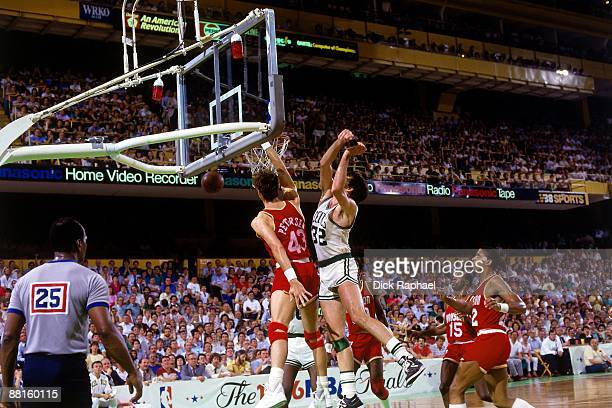 Jim Peterson of the Houston Rockets dunks against Kevin McHale of the Boston Celtics in Game Six of the 1986 NBA Finals at the Boston Garden played...