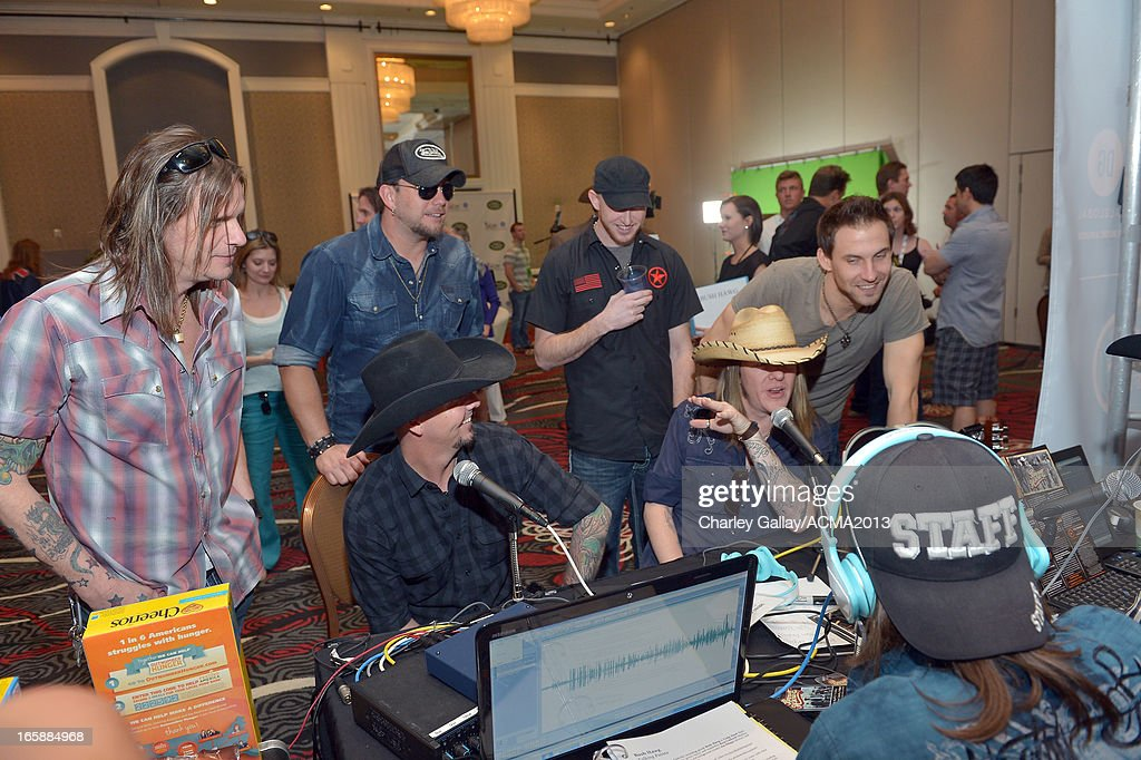 Jim Phipps, Ben Helton, Shaun Ames, Russ Caldwell, Craig Hand, and Alex Wilshire of music group Bush Hawg attend the Dial Global Radio Remotes during the 48th Annual Academy of Country Music Awards at MGM Grand Garden Arena on April 6, 2013 in Las Vegas, Nevada.