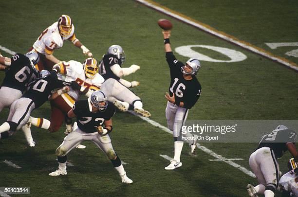 Jim Plunkett quarterback for the Oakland Raiders passes during Super Bowl XVIII against the Washington Redskins at Tampa Stadium on January 22 1984...