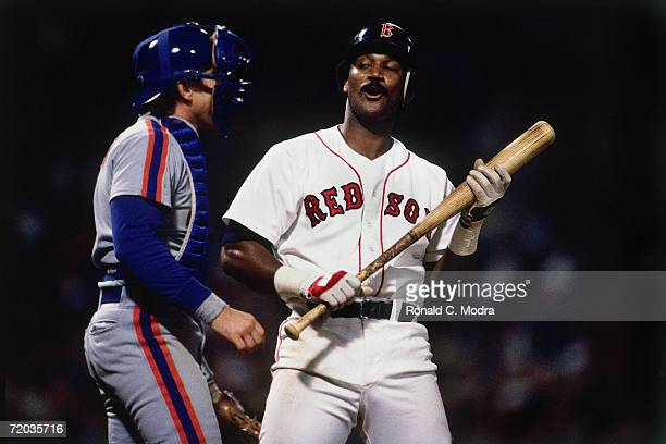 Jim Rice of the Boston Red Sox looks at Gary Carter of the New York Mets in Game 3 of the 1986 World Series against the Boston Red Sox at Fenway Park...