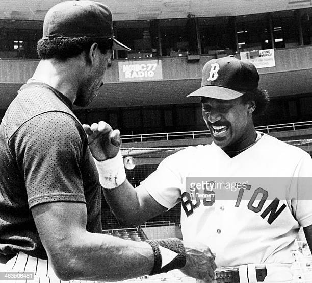Jim Rice of the Boston Red Sox slaps hands with Dave Winfield of the New York Yankees before their game on July 4 1983 at Yankee Stadium in the Bronx...