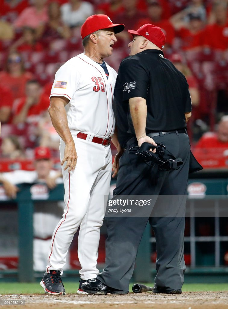 Jim Riggleman the manager of the Cincinnati Reds and umpire Eric Cooper exchange words in the 12th inning against the Chicago White Sox at Great American Ball Park on July 3, 2018 in Cincinnati, Ohio. Riggleman was ejected from the game and the Reds lost 12-8 in 12 innings.