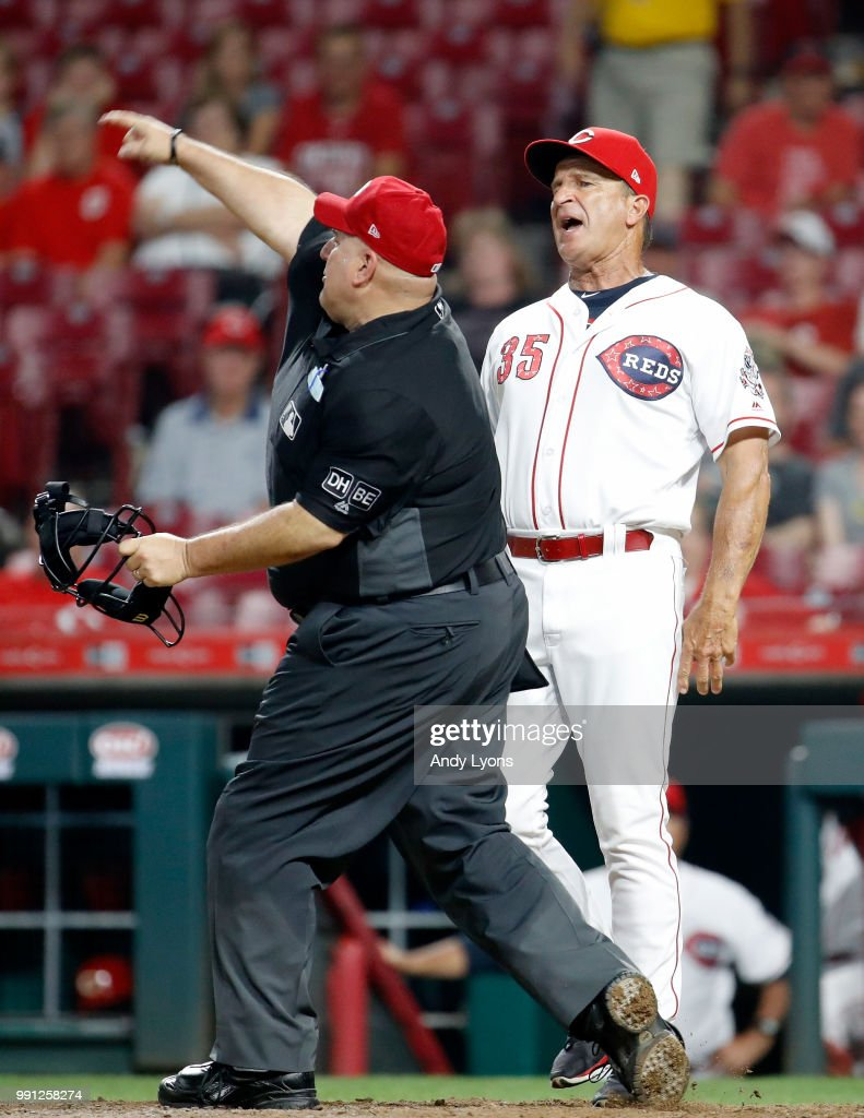 Jim Riggleman the manager of the Cincinnati Reds is ejected by umpire Eric Cooper in the 12th inning against the Chicago White Sox at Great American Ball Park on July 3, 2018 in Cincinnati, Ohio. The Reds lost 12-8 in 12 innings.