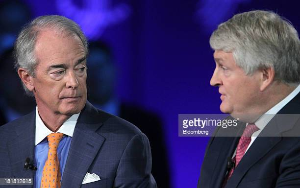 Jim Rogers chairman president and chief executive officer of Duke Energy Corp left listens as Denis O'Brien chairman and cofounder of Digicel Group...