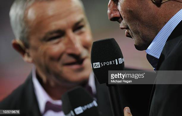 Jim Rosenthal and Andy Townsend present coverage for ITV Sport during the 2010 FIFA World Cup South Africa Group C match between England and USA at...