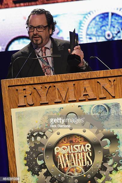 Jim Runge accepts the Road Warrior of the Year award on behalf of Gus Brandt at the 26th Annual Pollstar Awards at Ryman Auditorium on February 21...