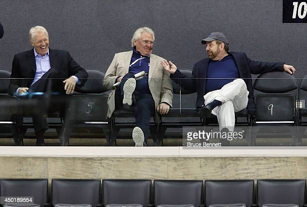 Jim Schoenfled Glen Sather and James Dolan of the New York Rangers watch a practice session on an off day during the 2014 NHL Stanley Cup playoffs at...
