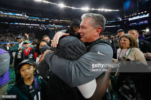 Jim Schwartz defensive coordinator of the Philadelphia Eagles celebrates with LeGarrette Blount after their teams 4133 victory over the New England...