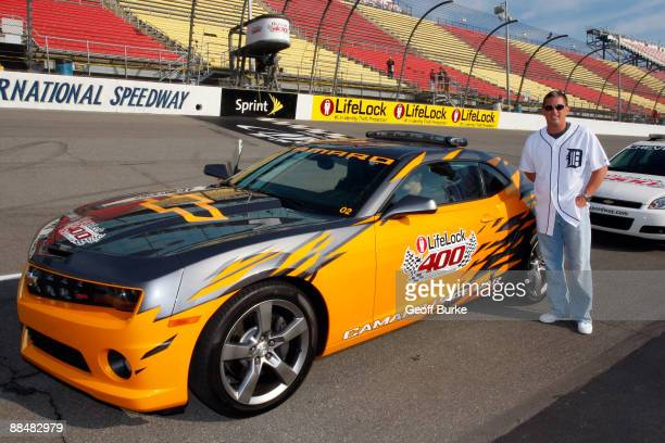 Jim Schwartz Head Coach of the National Football League's Detroit Lions poses in front of the pace car prior to the start of the NASCAR Sprint Cup...