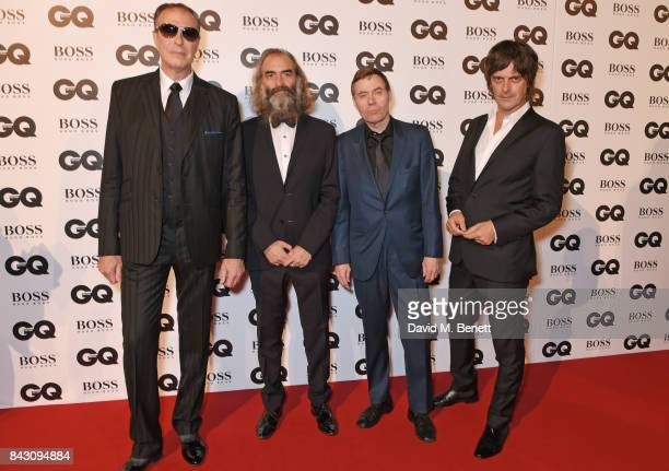 Jim Sclavunos Warren Ellis Thomas Wydler and George Vjestica of Nick Cave The Bad Seeds attend the GQ Men Of The Year Awards at the Tate Modern on...