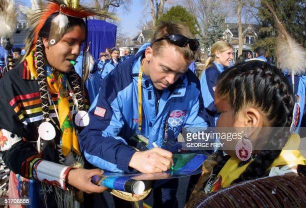 Jim Shea a member of the US Olympic Team and medal hopeful signs autographs for NativeAmericans Miali Snowpeach and Antoine Cantsee at the Olympic...